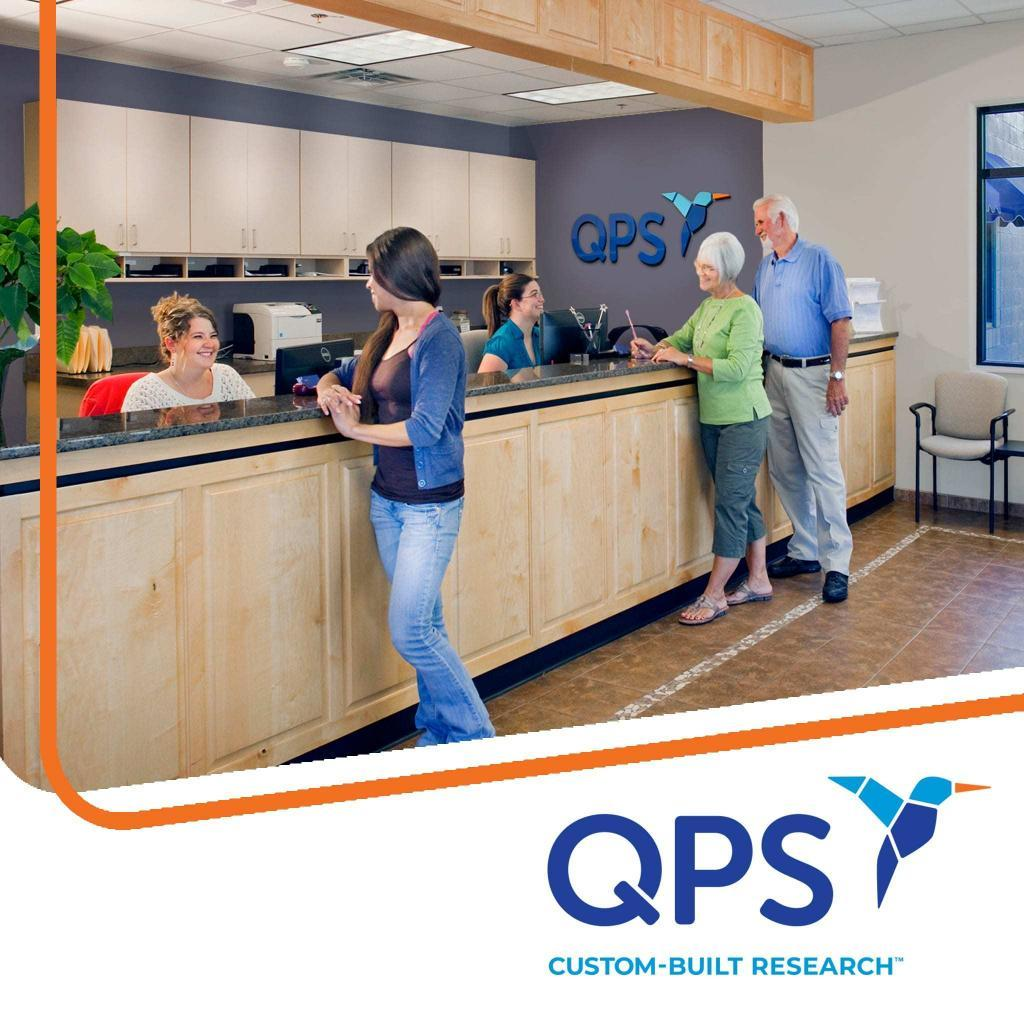 Lobby of QPS, volunteers speaking to smiling receptionists