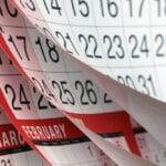 Close-up of flipping through calendar pages